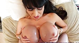 Tittyfucking busty MILF gobbles his cock